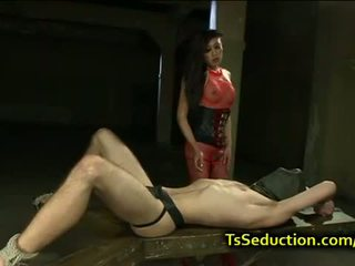 Blindfolded tied up guy fucked by tranny