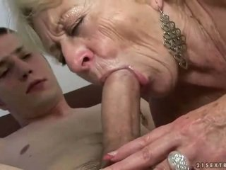 Granny and boy enjoying hard sex