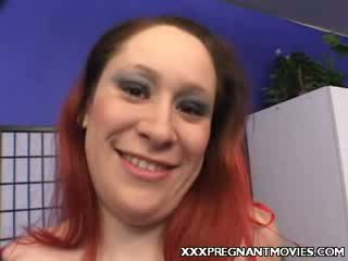 Preggy donker haired striptease