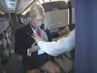 Stewardess makes his cock feel good