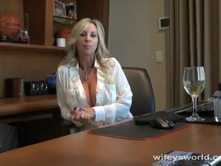 Busty doctor blows cock