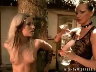 Mistress punishing beautiful girl