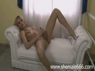 Blonde tranny shove dildo up the ass