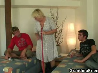 Blond oma swallows two cocks