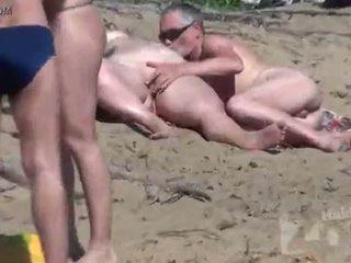 Naakt strand voyeur