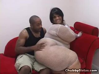 Erotic Sized Great Spicy Chocolate Donna Farrah Fox Is Sitting Onto A Scarlet Bed Wearing A White Fishnet And Nothing Underneath. Rock Bends Her Over And Slaps Her Chunky Ass, Causing Some Motion In