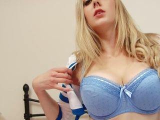 Gorgeous blonde cheerleader strips to show her huge tits
