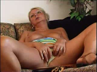 Busty mature blonde with a dildo