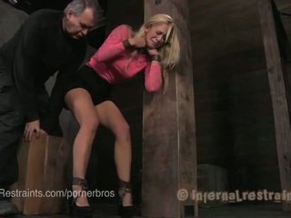 Blonde in metal & leather bondage predicaments