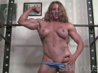Ripped Female Bodybuilder Ironfire Works out and Poses