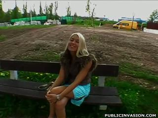 Turned on blonde in blue dress gives blowjob in public