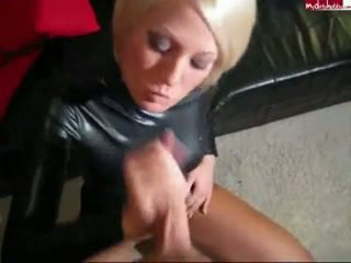 Blonde in Leather Sucking Cock