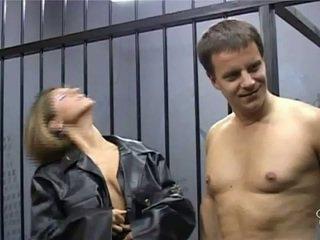 Two female guards pleasure prisoner cock