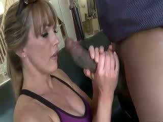 Horny MILF feeds on a big black cock