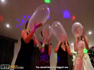 Amateur Prostitutes Drinking Champagne From Condoms