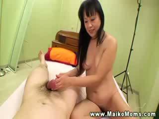 asian mature drools and jerks Cock before climbing on it