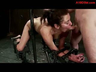 Gyz tied to metal frame in doggy getting her amjagaz and mouth fucked by ýaş gyz with strapon and master in the ýeriň aşagynda