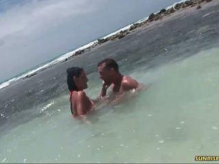 Hot brunette teen slut gives head in the ocean