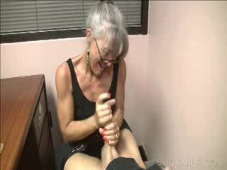 Lusty cougar giving Handjob on knees
