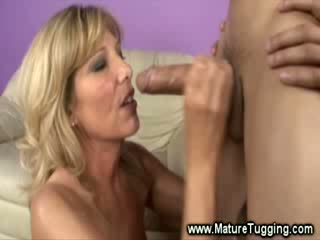 Mature blonde whore is sucking a cock
