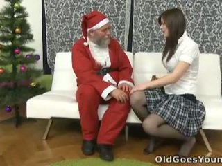Old santa clause gives young teen a gift