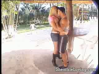 Nasty blonde shemale is down on her knees getting fucked by horny guy