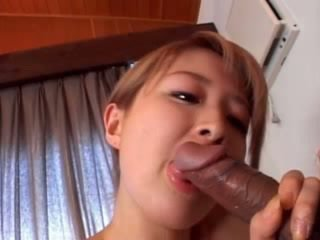 Superb asian babe giving blowjob in bed