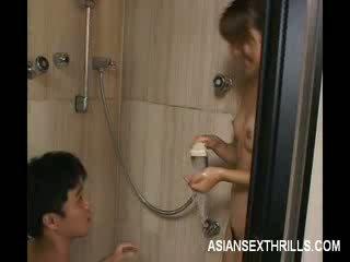 Asian model strips in the Shower
