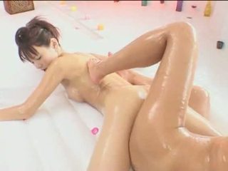 Asian Lesbian Oiled and Having Sex Video