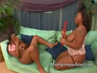 Pair of ebony lesbians getting it on as a milf gets between the legs of a babe