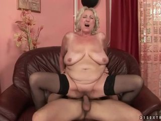 Gorgeous blonde granny rides a stiff prick