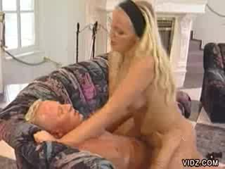 Blonde chick rides mature man's fat cock