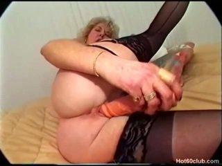 Granny dildo fucks her pussy