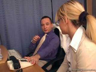 Blonde secretary with the glasses doing blowjob action