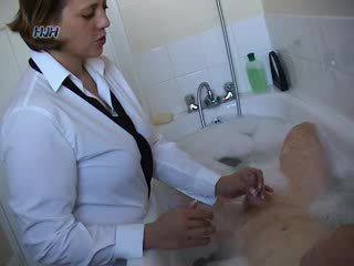 Guy in a bath getting a handjob from an office worker
