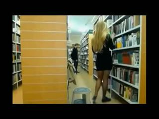 Girl caught in the library giving a show on w