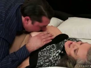 Busty grandma making love with her young boyfried