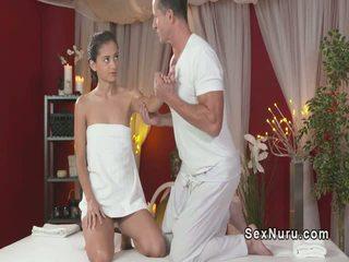 Horny masseur fucks slim brunette