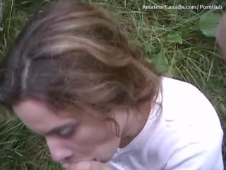 Busty brunette sucks cock and fingers in public park