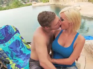 Big tit blonde gets fucked outside by pool