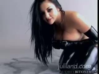 Dark haired bitch in black latex with gloves masturbating