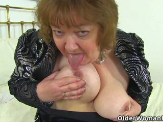 English Granny Susan Pleases Her Hungry Pussy with a...