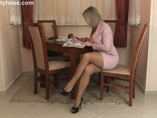 Sexy blonde cougar in pantyhose stripping and teasing