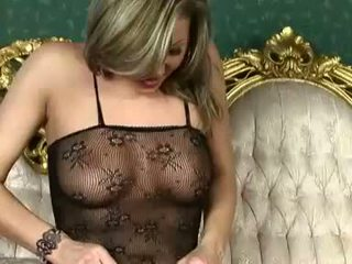 Sensual blondie Caroline Cage heats up in her sexy lingerie for some action