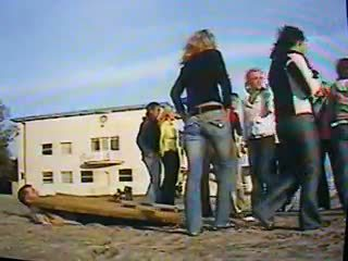14 girls trample man under board