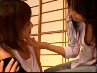 Asian girl getting her fake cock rubbed licking other girl p