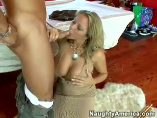 Juicy hot pornstar Amber Lynn Bach hooks a meaty pole in her steamy mouth
