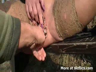 Fisting her monster pierced pussy outdoors