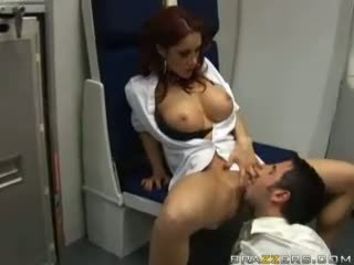 Busty brunette sucks cock of some guy in airplane