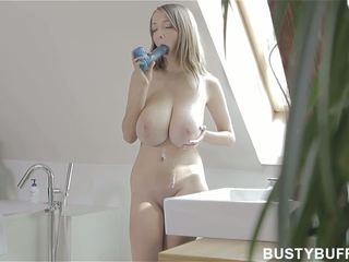 Busty Buffy sucking on big toy